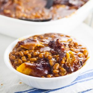 Homemade Bacon Baked Baked Beans are easier to make than you think!Sweet and tangy Homemade Bacon Baked Beans, slow baked with bacon are the perfect summer side dish for your next barbecue or cookout! Yum!