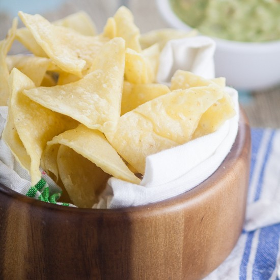 Homemade Corn Tortilla Chips are easy to make!A simple recipe to make your own Homemade Corn Tortilla Chips that are absolutely delicious. Store bought tortilla chips just can't compete with these crunchy fresh ones!