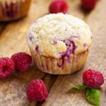 Raspberry Streusel Muffins Recipe - Sweet but tart, these fresh Raspberry Streusel Muffins topped with a heavenly, crunchy streusel will make breakfast a decadent treat.  Easy breakfast recipe that's also freezer friendly. Fabulous!