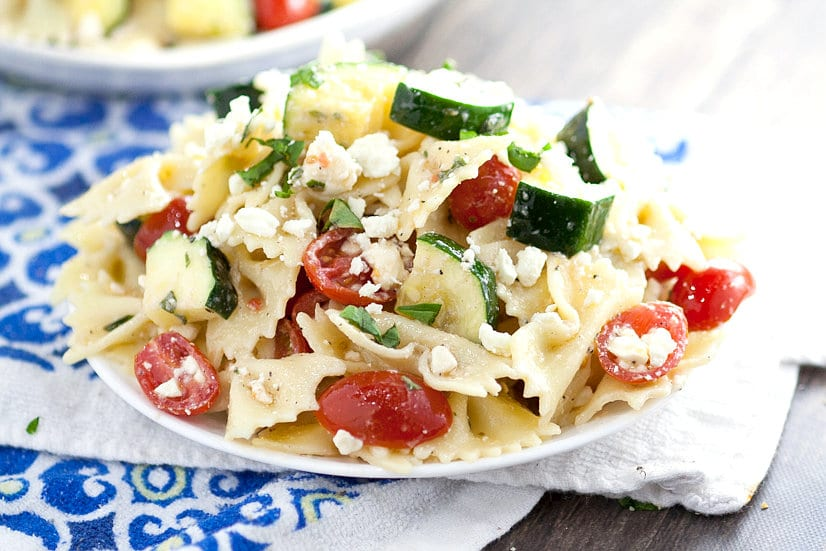 Fresh Zucchini Farfalle Pasta Salad recipe - Quick and easy Fresh Zucchini Farfalle Pasta Salad recipe is a simple pasta salad with bowtie pasta, creamy feta and tomatoes and is sure to be a hit at every cookout and potluck. Great for a crowd! This looks so fresh and tasty!
