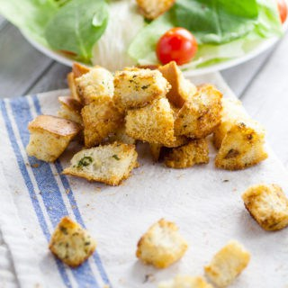 Homemade Garlic Croutons recipe - Skip the store bought croutons and make this crunchy, buttery, and zesty Homemade Garlic Croutons recipe for the perfect delicious topping on your favorite salad! These look so good.