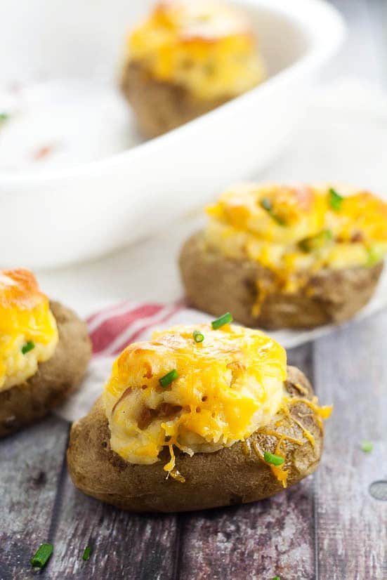 Twice Baked Deviled Potatoes recipe -Named after their eggy-likeness, these Twice Baked Deviled Potatoes are tangy baked potatoes, whipped, and oven-baked to golden perfection. Yummy and easy potato side dish recipe!