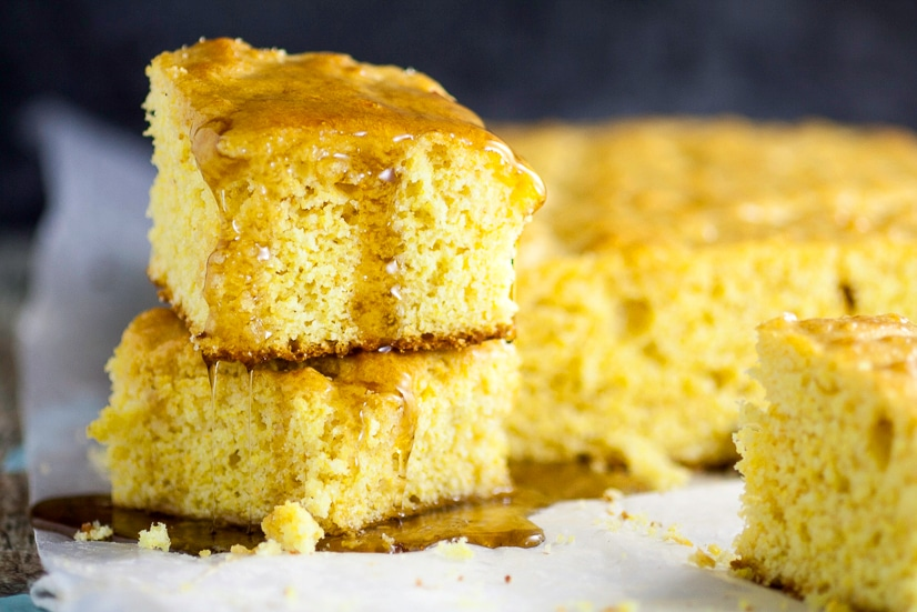 Maple Cornbread Recipe - A sweet, maple twist on a classic favorite, this homemade Maple Cornbread recipe is made from scratch and takes traditional cornbread to a whole new delicious level. A delicious Fall twist on a traditional favorite.  Yummmm!
