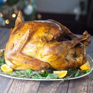 Butter Herb Roasted Turkey recipe that's perfect for a classic Thanksgiving turkey recipe -Golden, juicy, and delicious, this Butter Herb Roasted Turkey recipe won't disappoint with a hint of buttery herb flavor and a beautiful color. Will be the highlight of your holiday table!