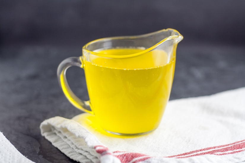 How to Make Clarified Butter in the Microwave Tutorial -Learn how to make clarified butter in the microwave in just 5 simple steps. Drawn butter is perfect for your favorite seafood and so easy to make! Wow! This will be perfect the next time we have surf and turf at home!
