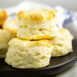 These simple homemade Southern Buttermilk Biscuits are flaky and tender. They're easy to make at home from scratch. Slather them in butter and see just how deliciously light and tender they are.