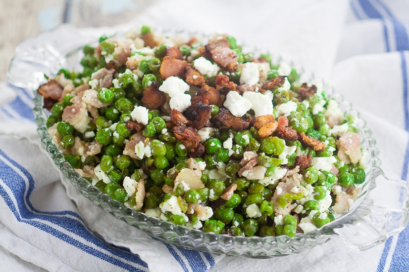 Feta Bacon Peas Recipe -Peas cooked with salty crunchy bacon then tossed with tangy, creamy Feta cheese for a delightful, unique side dish. Make this Feta Bacon Peas quick and easy side dish recipein just 20 minutes!