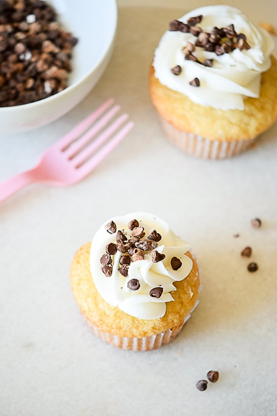 Chocolate Chip Cupcakes Recipe - A classic and favorite, this Chocolate Chip Cupcakes recipe morphs your favorite cookie into a cupcake with a dollop of sweet buttercream on top.