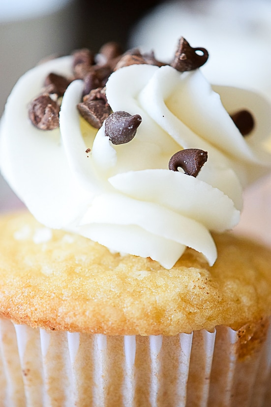Chocolate Chip Cupcakes Recipe -A classic and favorite, this Chocolate Chip Cupcakes recipe morphs your favorite cookie into a cupcake with a dollop of sweet buttercream on top.