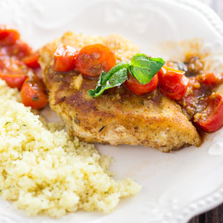 Breaded Chicken with Tomatoes Recipe - Simple but delicious, this Breaded Chicken with Tomatoes recipe has Parmesan Italian breaded chicken breasts with a zesty tomato sauce to make an amazing dinner.