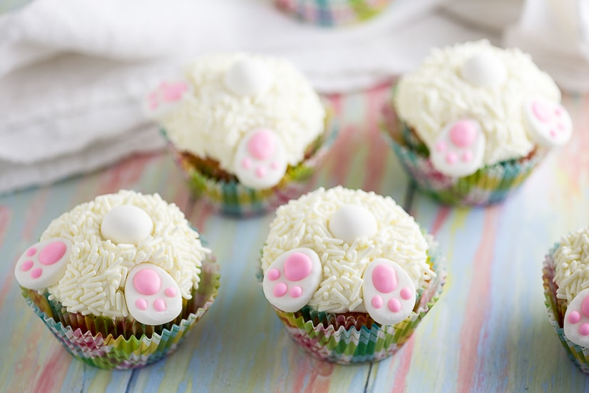 Bunny Butt Cupcakes tutorial -Make these adorable and easy Bunny Butt Cupcakes as asilly Easter treat for kids. Little bunny butts on top of your favorite cupcakes will make the cutest Easter cupcakes around!