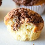 Nutella Banana Muffins Recipe - Decadent chocolate and creamy sweet bananas make a heavenly combination that's perfect, even for breakfast in this Nutella Banana Muffins recipe! Great breakfast idea for kids and freezer friendly too.