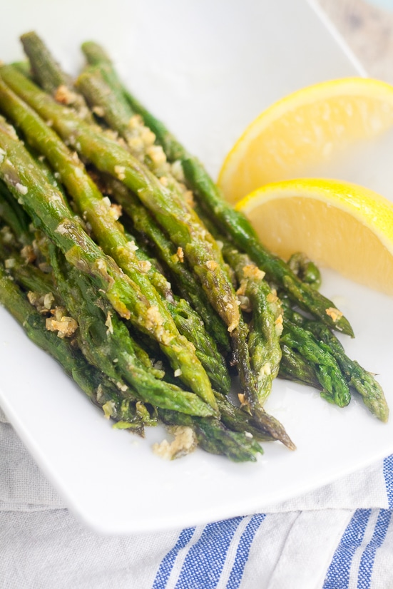 Oven Roasted Asparagus recipe - Oven Roasted Asparagus is a simple side dish that takes just minutes to prep. With garlic and Parmesan cheese, it's all fresh flavor and no hassle!  Super easy side dish recipe that's super delicious too.