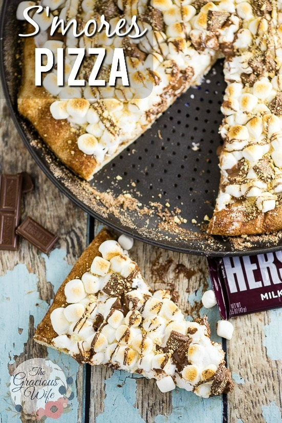 S'mores Pizza Recipe -S'mores Pizza with tons of gooey marshmallows and rich, decadent HERSHEY'S Milk Chocolate with a marshmallow cheesecake sauce, a chocolate drizzle, and a sprinkle of graham crackers, all on top of a cinnamon-sugar crust. This is such a quick and easy dessert recipe and it is soooo good. My kids love it. And I probably love it even more. Who doesn't love s'mores?
