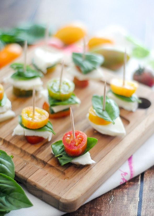 Caprese Bites Recipe -A fresh and simple appetizer or snack, these Caprese Bites are easy to make and delicious to eat! Great way to use up fresh Summer produce. Super easy appetizer recipe!