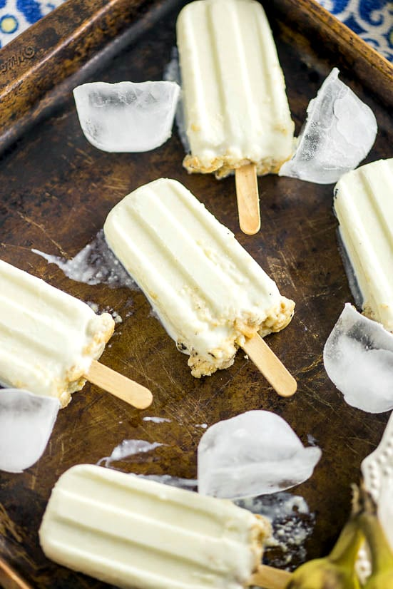 Banana Cream Pie Popsicles Recipe - Taking Banana Cream Pie to the next level, these Banana Cream Pie Popsicles will keep you cool and satisfied on a hot summer day. Just 4 ingredients to make this quick and easy popsicle recipe!