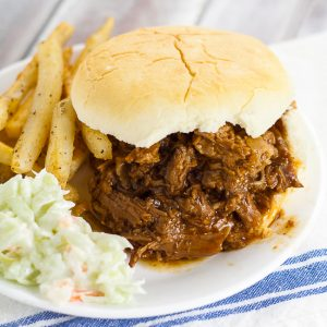 Crock Pot Root Beer Pulled Beef Sandwiches recipe -A 5 ingredient fix-it-and-forget-it slow cooker dinner, this Crock Pot Root Beer Pulled Beef recipe has the perfect combination of tangy sweetness and takes just minutes to throw together! Easy slow cooker recipe perfect for family