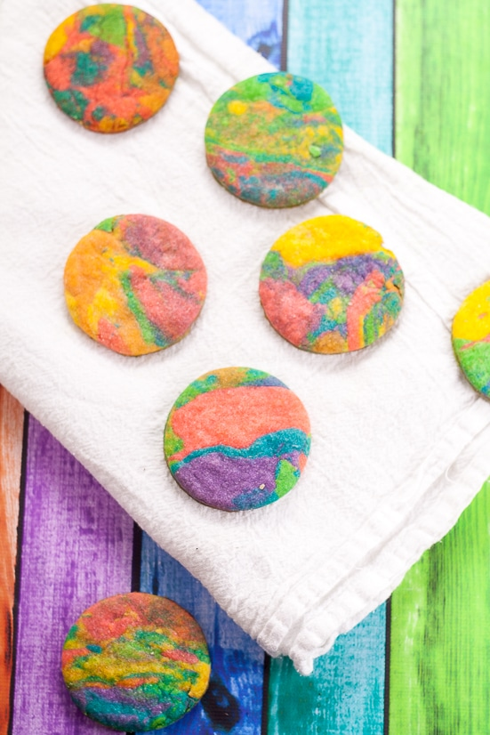 Tie Dye Cookies Recipe and Tutorial - Fun, easy, and bright, these adorable Tie Dye Cookies are a delicious and colorful treat that kids will love for a fun addition to any party!  Fun food for kids