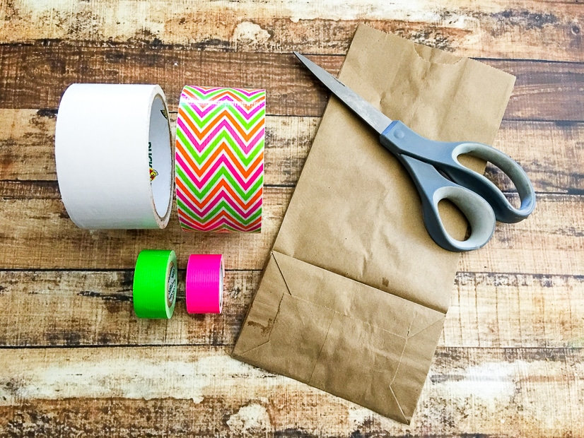Easy DIY Duck Tape Lunch Box - Make this fun and cute Duck Tape Lunch Box for an easy and useful back to school DIY project that the kids will love making and using! Simple to make and an easy to follow tutorial!