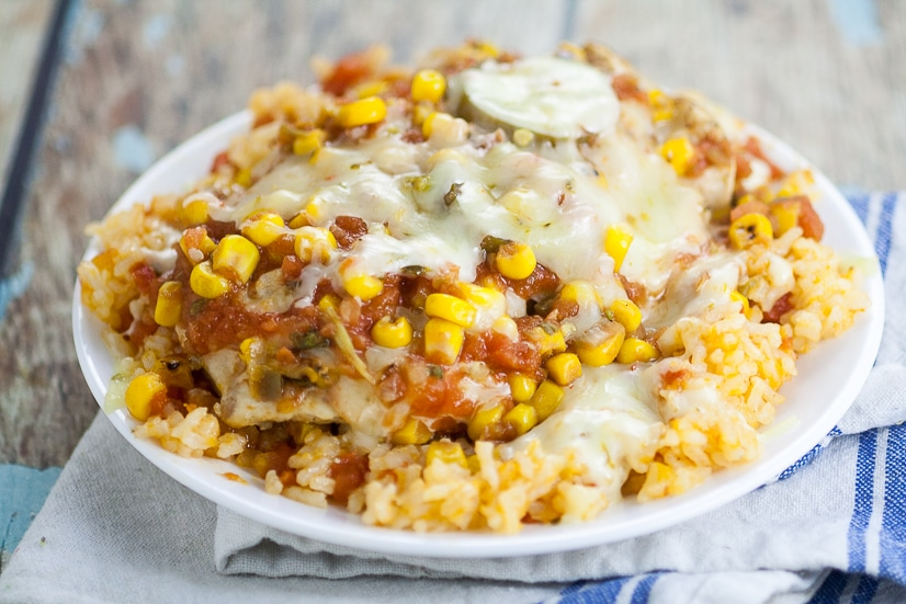 Skillet Southwest Smothered Chicken Recipe -Cheesy and zesty and made in just 30 minutes in one skillet! This Skillet Southwest Smothered Chicken recipe has it all and will be a new family favorite! Quick and easy family dinner recipe