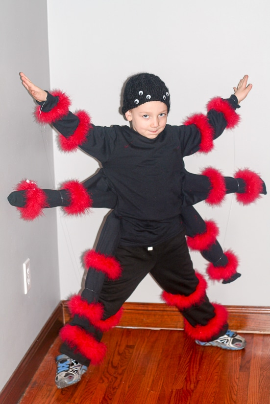 DIY Spider Costume for Kids -Make this easy, fun, and creepy DIY Spider Costume for Kids for a creepy crawly frugal do it yourself Halloween costume! So cool. Made from just a few black shirts!