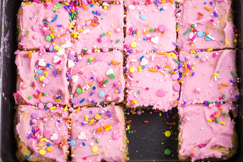 These soft and chewy Frosted Sugar Cookie Bars are the perfect kid-friendly dessert that the whole family will love! Super soft sugar cookie bars piled with vanilla buttercream frosting and lots of sprinkles! So easy to bake since they're in bar form!