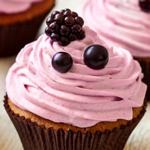 Top your favorite cupcakes with gorgeous swirls of fresh, sweet, and tangy homemade Blackberry Frosting. Make this blackberry frosting to adorn your treats with just 6 ingredients!