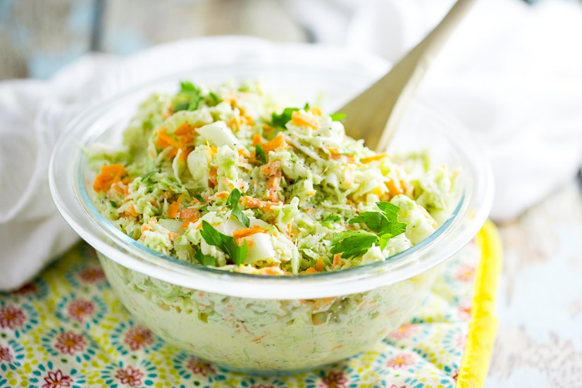 This quick and easy homemade Creamy Southern Coleslaw is the perfect combination of creamy, sweet, fresh, and tangy. It makes a delicious side and it's my favorite for pulled pork, too! It is just indescribably good. You have to try it for yourself!