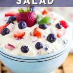 This easy Berry Cheesecake Salad features fresh, juicy berries in a creamy cheesecake mixture that make the most amazing fruit salad ever! Made with vanilla pudding, whipped cream, marshmallows, and fresh berries! Your family will go nuts over it! Perfect for a party or a crowd! There won't be any leftovers!