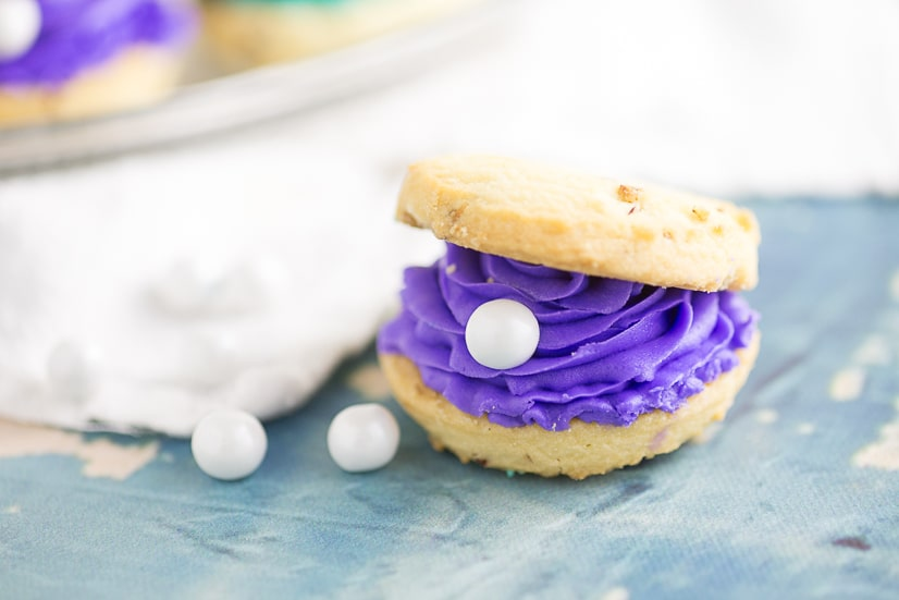 Oyster Cookies with pearlsare the perfect treat for a mermaid, beach, Finding Nemo, Finding Dory, or under-the-sea themed party!Everything's better under the sea, including these colorful oyster pearl cookies!