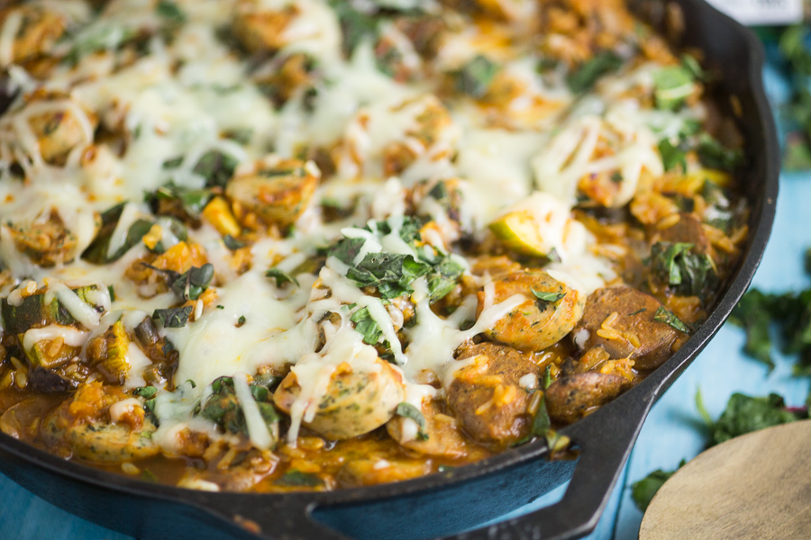Zesty spinach chicken sausage and fresh veggies in a vibrant tomato sauce and covered in cheese in this Cheesy Chicken Sausage and Spinach Skillet Dinner recipe for an easy family dinner made in just one skillet in 30 minutes.This quick and easy sausage, veggie and rice skillet is downright delicious!