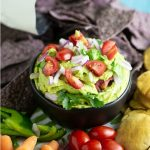 Healthy Avocado Cilantro White Bean Dip is a speedy snack that's full of flavor. This quick, easy, and healthy bean dip recipe is made with white beans, avocado, and cilantro and is so creamy! Quick and easy, and even perfect for last-minute party apps.