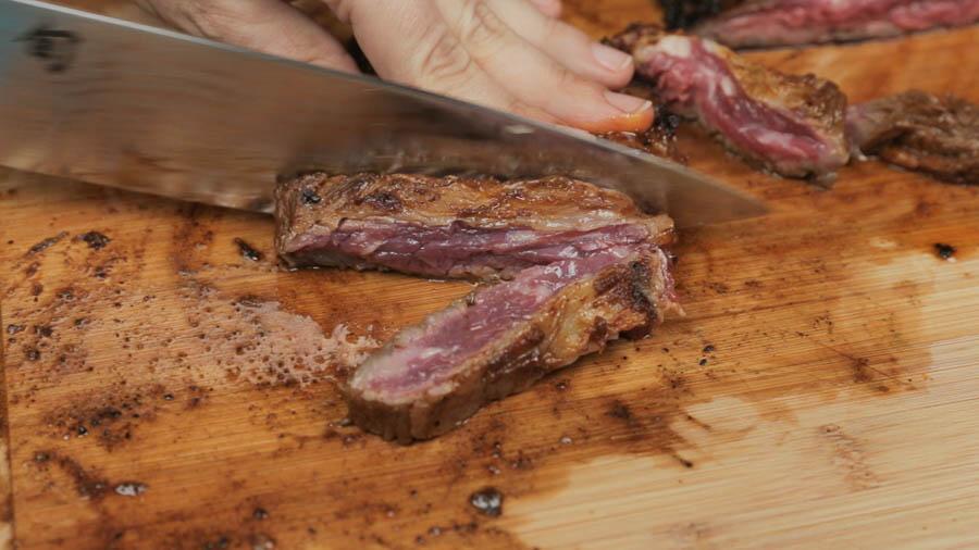 Cutting cooked skirt steak for fajitas