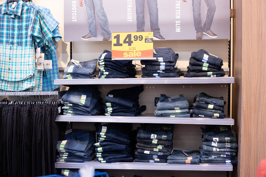 Stacks of blue jeans on shelves at Meijer