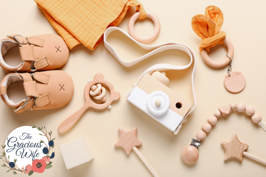 Wooden baby toys scattered around plain neutral surface